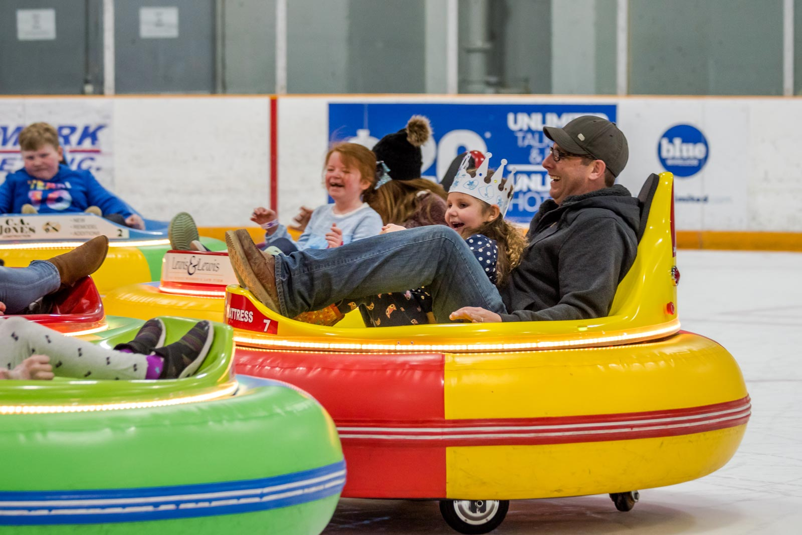 A young girl wearing a Birthday Crown bumps into her friends in the Ice Bumper Car