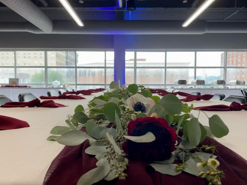 head table display with windows in the background