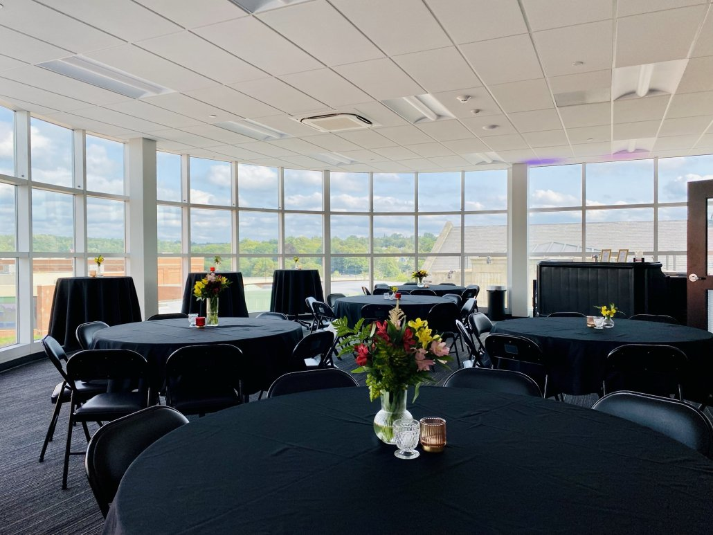 tables with black linens in the Atrium Boardroom and Rooftop Patio