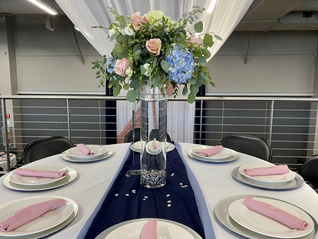 draping over wedding reception table display